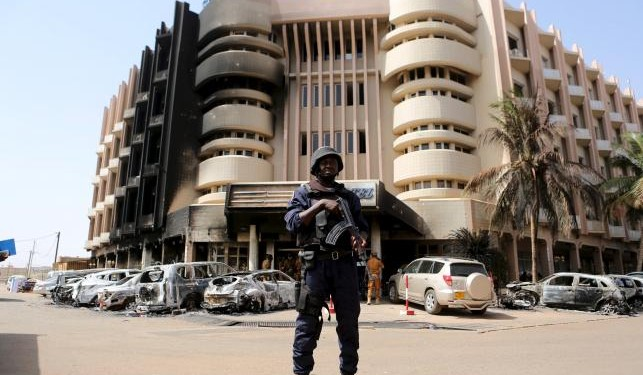 A soldiers stands guard in front of Splendid Hotel in Ouagadougou after the Burkina Faso hotel attack