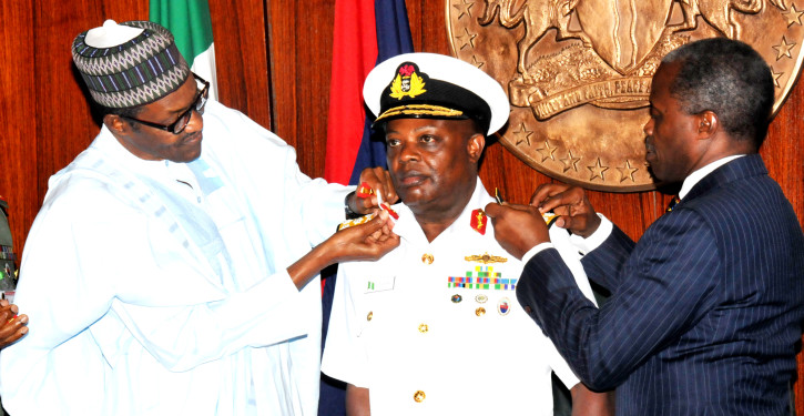PIC 3.  PRESIDENT MUHAMMADU BUHARI (L)  AIDED BY VICE-PRESIDENT YEMI   OSINBAJO  IN DECORATING THE CHIEF OF NAVAL  STAFF, IBOK ETE EKWE  IBAS  WITH HIS NEW RANK OF VICE-ADMIRAL, AT THE PRESIDENTIAL   VILLA IN ABUJA ON THURSDAY (13/8/15). 5928/13/8/2015/ICE/CH/NAN