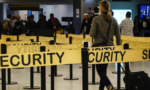 Passengers make their way in a security checkpoint at the International JFK airport in New York October 11, 2014. Medical teams at New York's JFK airport, armed with Ebola questionnaires and temperature guns, began screening travelers from three West African countries on Saturday as U.S. health authorities stepped up efforts to stop the spread of the virus. REUTERS/Eduardo Munoz (UNITED STATES - Tags: TRANSPORT HEALTH TRAVEL) (Newscom TagID: rtrlsix690548.jpg) [Photo via Newscom]
